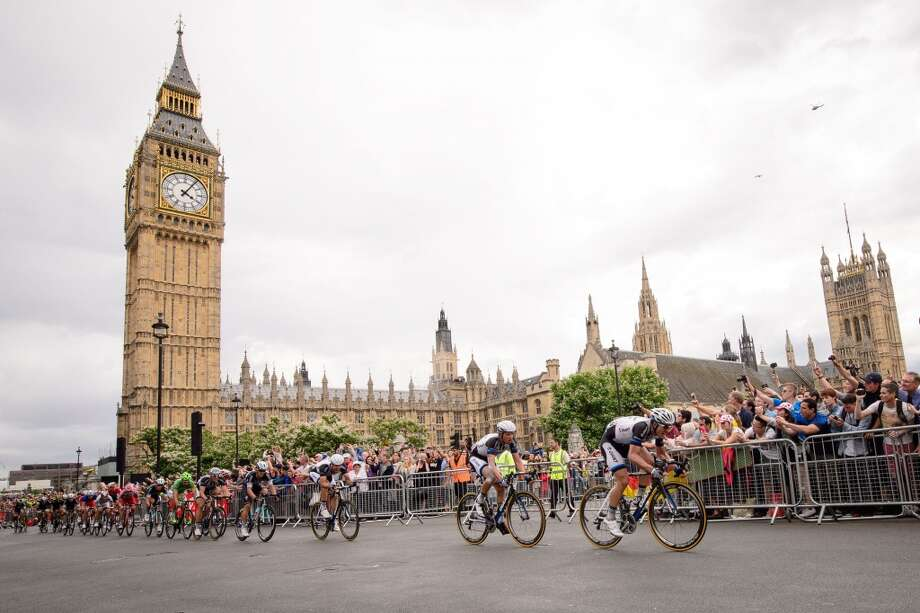 Riders pass the Houses of Parliament near the finish of the third stage. Photo: LEON NEAL, AFP/Getty Images