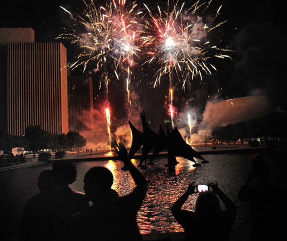 Spectators take in the fireworks display during the Fourth of July celebration on Friday July 4, 2014, at the Empire State Plaza in Albany, N.Y. (Cindy Schultz / Times Union) Photo: Cindy Schultz, Albany Times Union / 00027120A