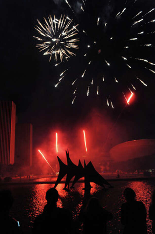 Fireworks during the Fourth of July celebration on Friday July 4, 2014, at the Empire State Plaza in Albany, N.Y. (Cindy Schultz / Times Union) Photo: Cindy Schultz, Albany Times Union / 00027120A