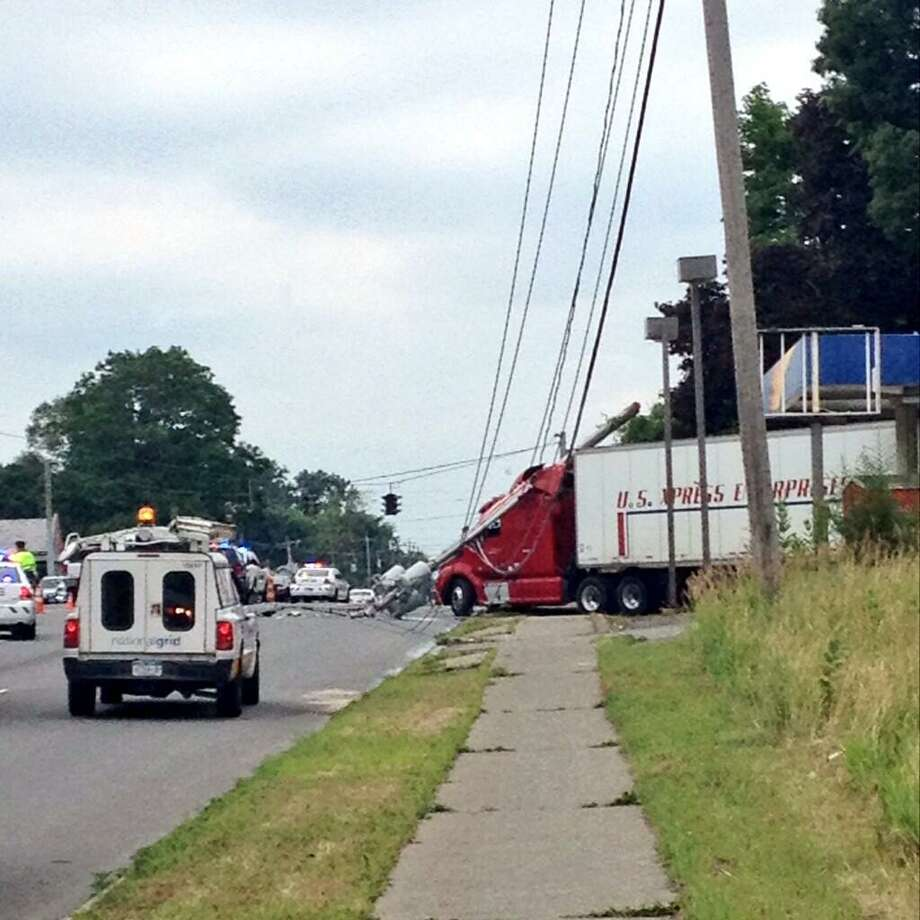 A trruck is stuck under wires on Route 20 near the Crossgates Mall entrance in Guilderland. (Selby Smith/Times Union)