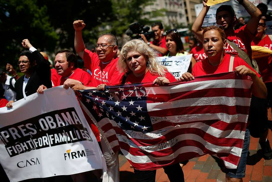 "WASHINGTON, DC - JULY 07: Immigration reform protesters march during an immigration rally July 7, 2014 in Washington, DC. Participants condemned ""the President's response to the crisis of unaccompanied children and families fleeing violence and to demand administrative relief for all undocumented families"". Following the rally, the protesters marched in front of the White House.  (Photo by Win McNamee/Getty Images) Photo: Win McNamee, Getty Images"