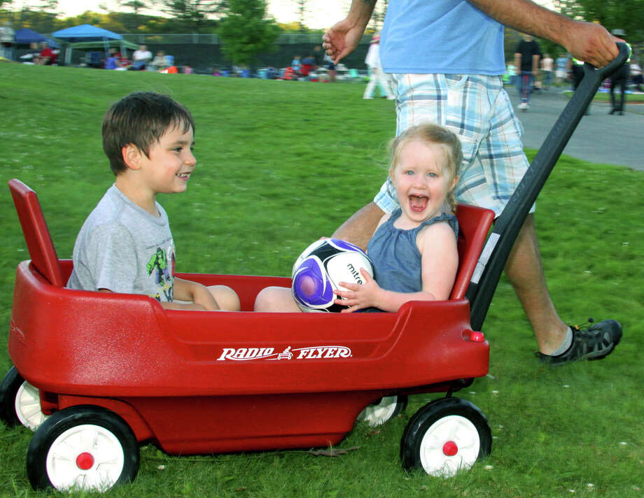 Mikey Carpanzano, 4, and Grace Cleary, 3, love their wagon ride during Washington's annual Fourth of July celebration on the campus of Shepaug Valley High School. Photo: Walter Kidd / The News-Times Freelance