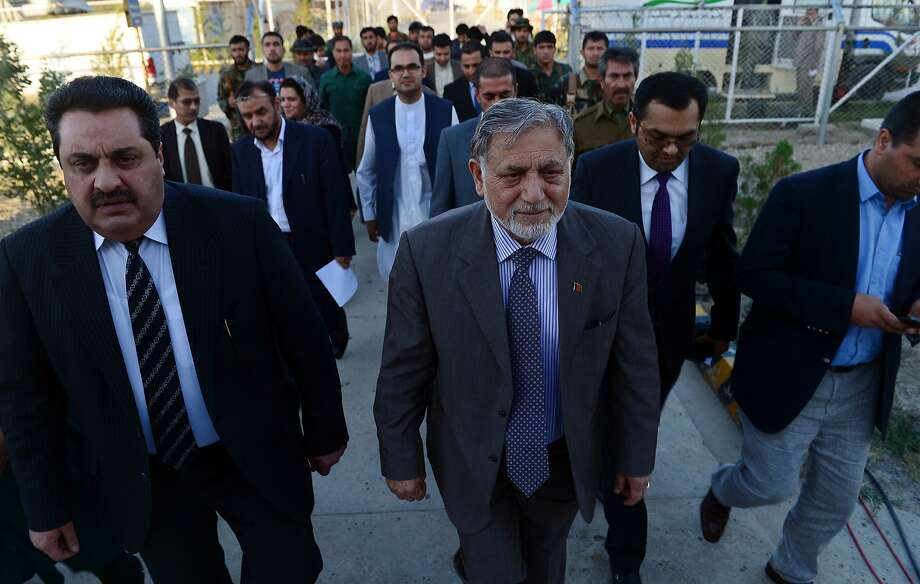 Head of the Afghan Independent Election Commission (IEC) Ahmad Yousuf Nuristani (C) arrives for a press conference in Kabul on July 7, 2014. Former World Bank economist Ashraf Ghani won Afghanistan's presidential election, according to preliminary results, with 56.4 percent of the run-off vote to Abdullah Abdullah's 43.5 percent. Officials said the turnout was more than eight million in the June 14 vote out of an estimated electorate of 13.5 million voters -- far higher than expected, and a figure likely to trigger further allegations of fraud from both sides. AFP PHOTO/Wakil KohsarWAKIL KOHSAR/AFP/Getty Images Photo: Wakil Kohsar, AFP/Getty Images