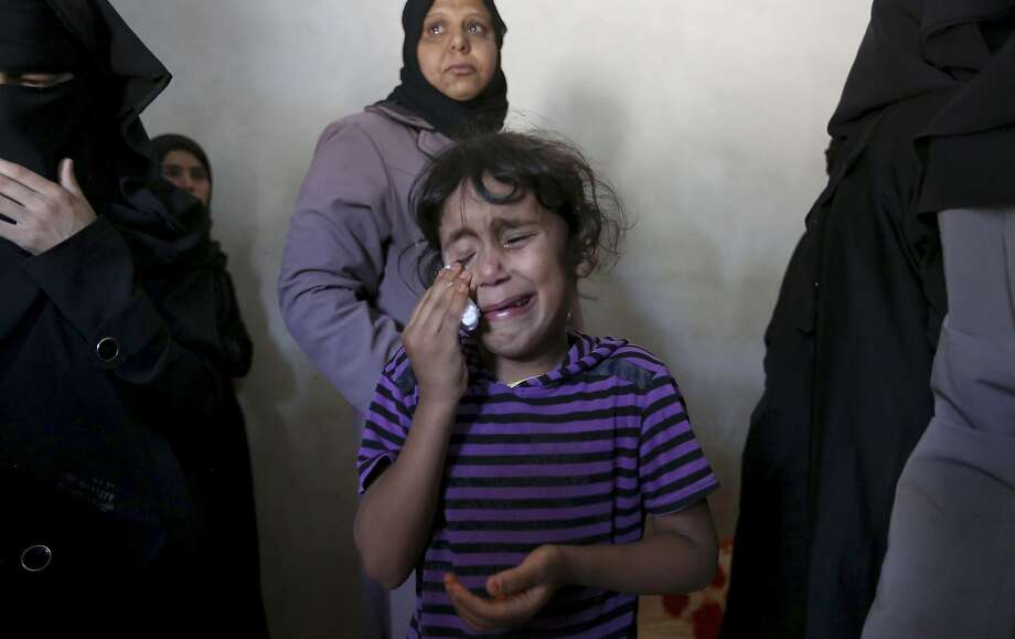 Asma weeps at the funeral of her brother, Gomha Abu Shalouf, 27, a member of Hamas who was killed in an Israeli air strike in the Gaza Strip. Photo: Hatem Moussa, Associated Press