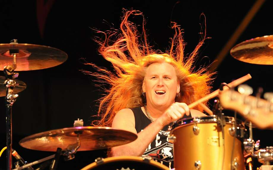 In case you were wondering what ever happened to Molly Hatchet ... Shawn Beamer drums as his hair 