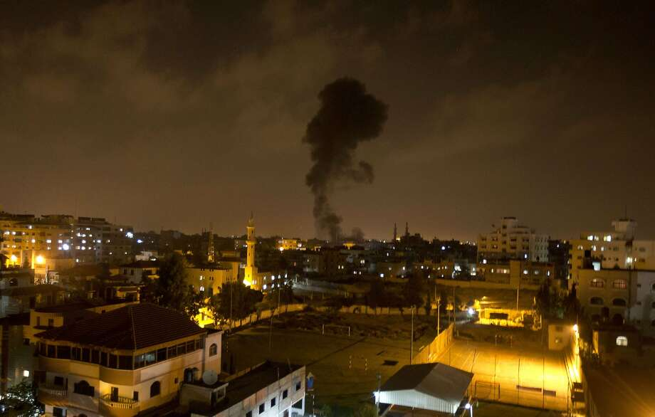 Drone kills militants:Smoke rises after an Israeli missile strike in Gaza City. Two Palestinian   fighters were killed and another wounded by an Israeli drone east of Bureij refugee camp, emergency   services said. Photo: Mahmud Hams, AFP/Getty Images