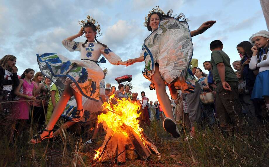 Sort of a heathen vaccination:Girls jump over a small bonfire while celebrating Ivan Kupala night, an ancient pagan holiday, in   the countryside near Turov, Belarus. Leaping over the flames supposedly safeguards the girls from illness   and bad luck. Photo: Viktor Drachev, AFP/Getty Images