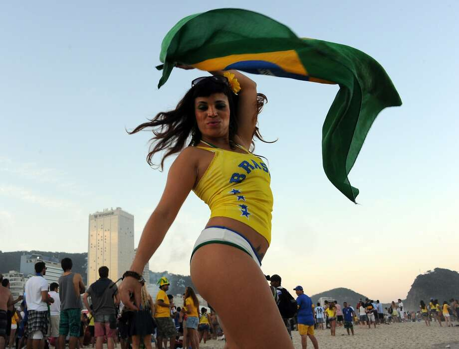 We can win it without Neymar! A Brazilian fan waves the national flag on Copacabana beach in Rio de 
