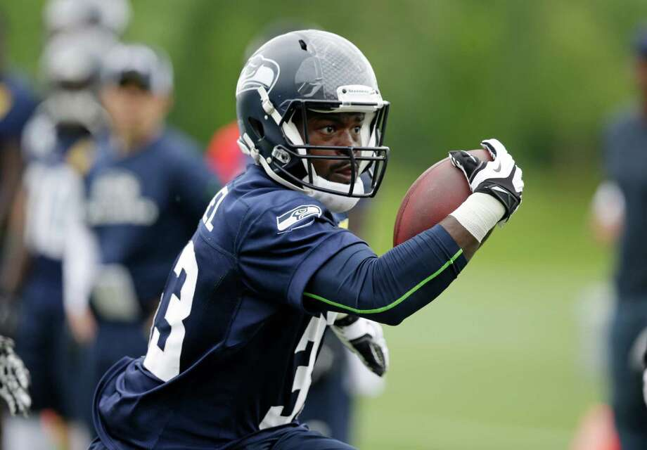 Seattle Seahawks' Christine Michael carries the ball at an NFL football minicamp practice Wednesday, June 18, 2014, in Renton, Wash. (AP Photo/Elaine Thompson) Photo: Elaine Thompson, STF / AP