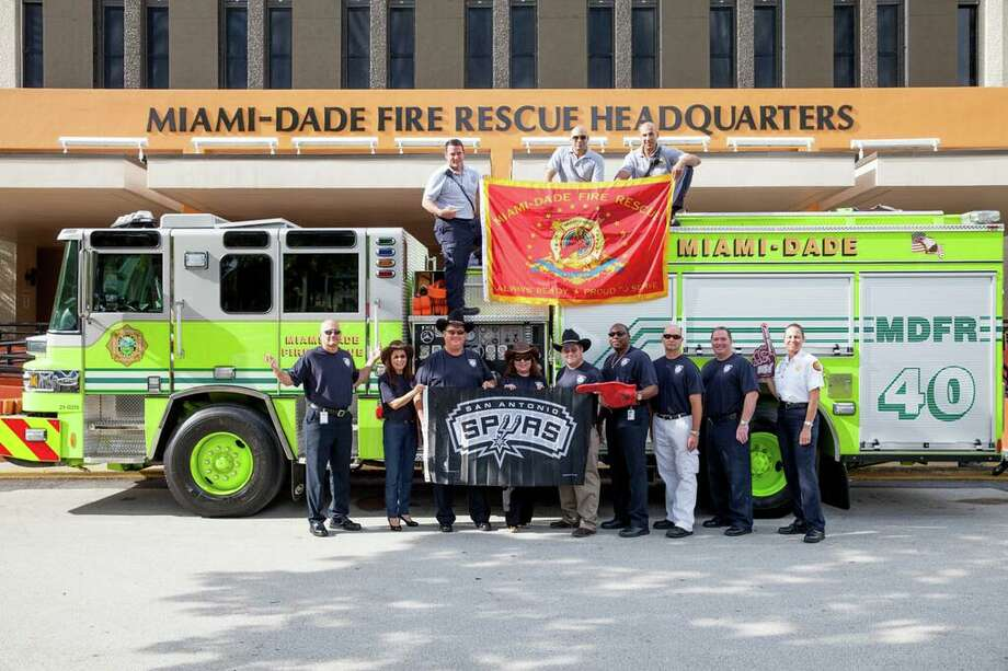 The South Florida firefighters sported SAFD T-shirts and made a donation after losing a bet on the NBA Finals. Photo: Courtesy