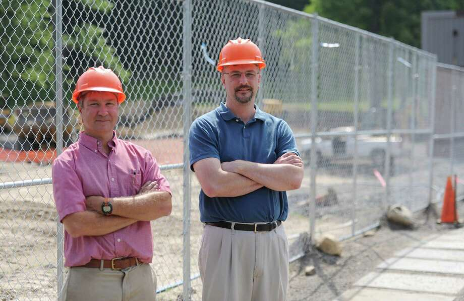 Berkshire Coporate Park Principal Greg Steiner, left, and Memry Vice President of Operations Tim Wilson pose outside the construction site of Memry in the Berkshire Corporate Park in Bethel, Conn. Monday, July 7, 2014. Photo: Tyler Sizemore / The News-Times
