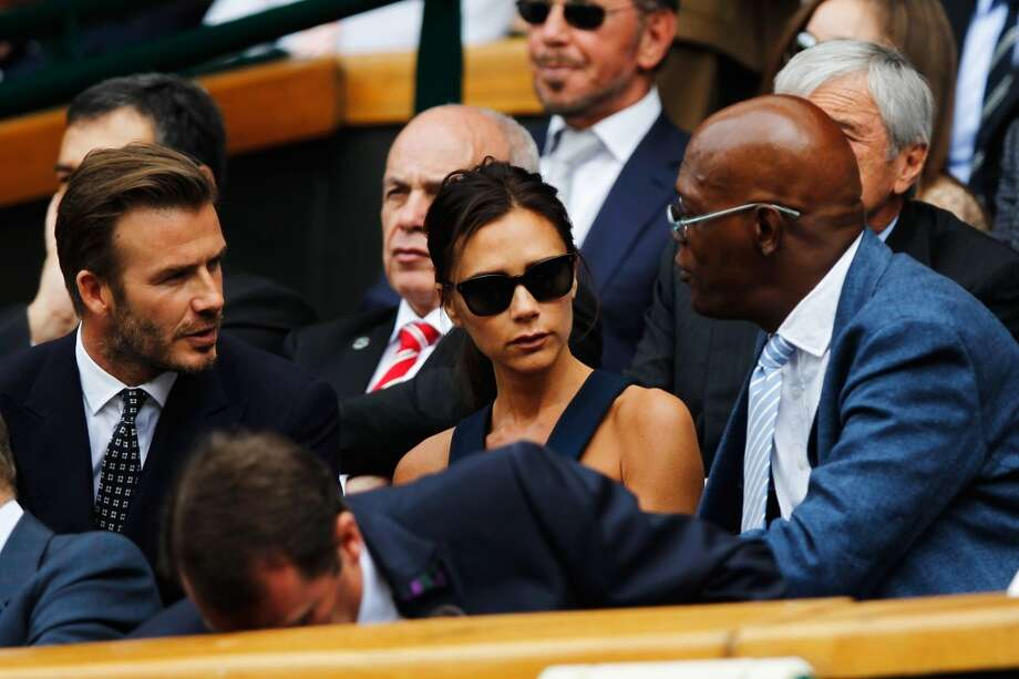 David Beckham, Victoria Beckham and Samuel L Jackson in the Royal Box on Centre Court at Wimbledon. Photo: Pool, Getty Images