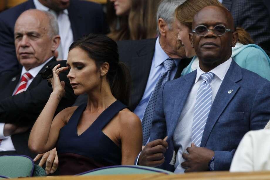 Actor Samuel L Jackson (R) and Victoria Beckham, at Wimbledon. Photo: SANG TAN, AFP/Getty Images