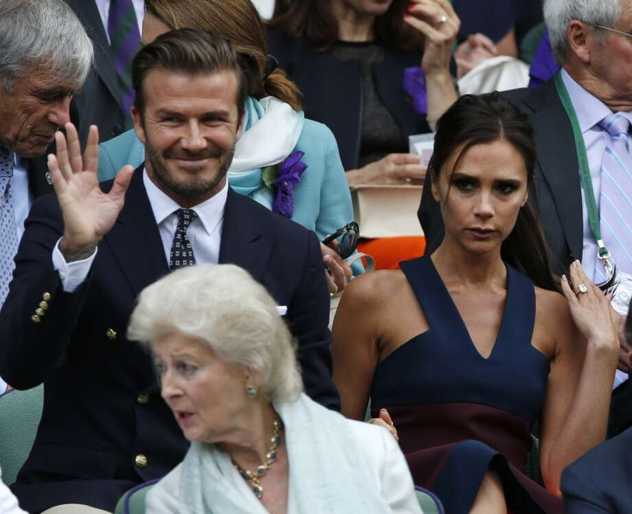David and Victoria Beckham take their seats in the Royal Box at Wimbledon. Photo: Ben Curtis, Associated Press