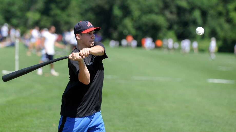 Ryan Vozzella of All American Wood takes a swing during Saturday's town-wide Greenwich Wiffle Ball Tournament at the Greenwich Polo Club on July 21, 2012. Photo: Lindsay Niegelberg