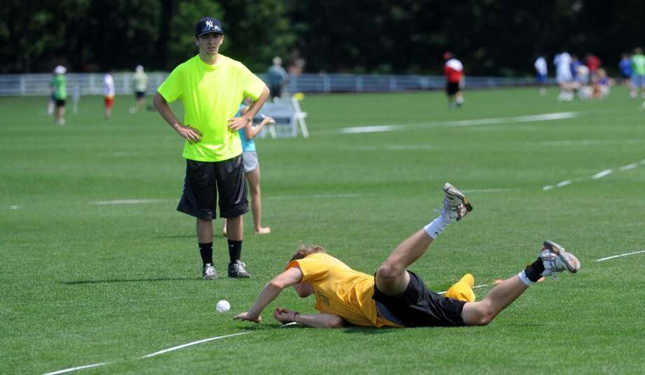 Sperry Edwards on team Carlyle Group dives for a ball during Saturday's town-wide Greenwich Wiffle Ball Tournament at the Greenwich Polo Club on July 21, 2012. Photo: Lindsay Niegelberg