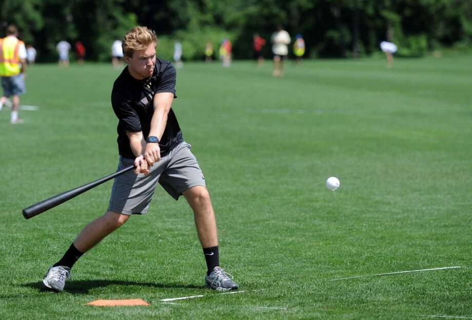 Michael Petrick of team Carlyle Group takes a swing during Saturday's town-wide Greenwich Wiffle Ball Tournament at the Greenwich Polo Club on July 21, 2012. Photo: Lindsay Niegelberg
