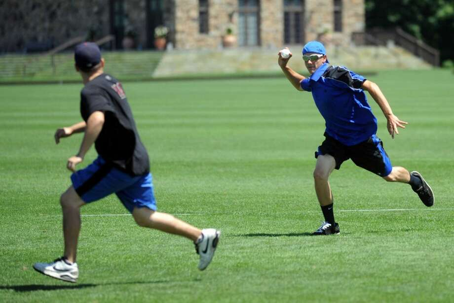 Ben Bright throws the ball during Saturday's town-wide Greenwich Wiffle Ball Tournament at the Greenwich Polo Club on July 21, 2012. Photo: Lindsay Niegelberg