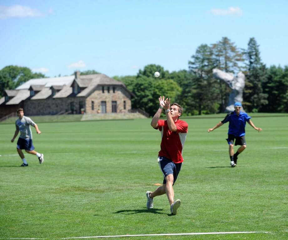 Tim Ferrone of team All American Wood makes a catch during Saturday's town-wide Greenwich Wiffle Ball Tournament at the Greenwich Polo Club on July 21, 2012. Photo: Lindsay Niegelberg
