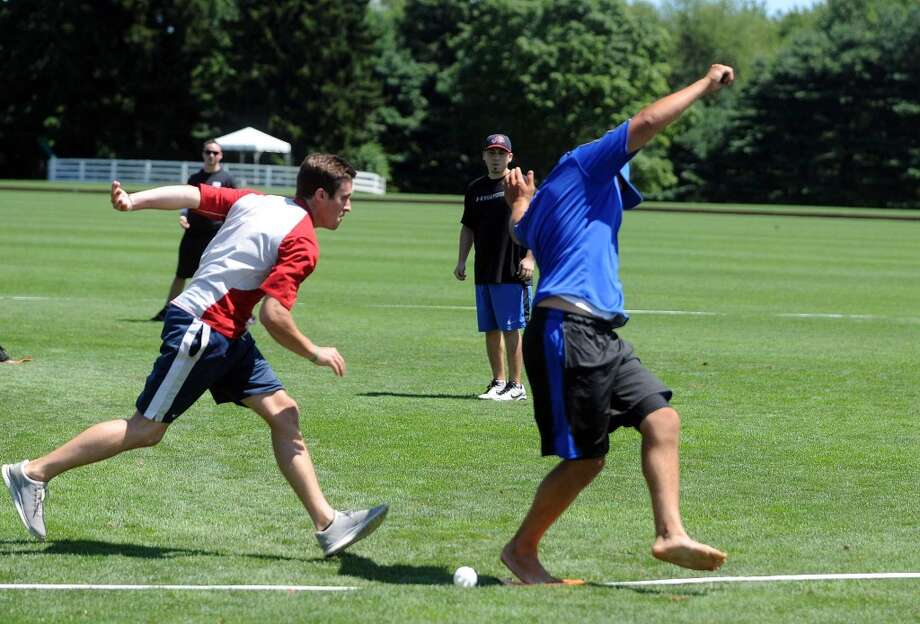 New Dub Order's Tim Welner is safe at first base as All American Wood's Tim Ferrone tries to peg him with the ball during Saturday's town-wide Greenwich Wiffle Ball Tournament at the Greenwich Polo Club on July 21, 2012. Photo: Lindsay Niegelberg