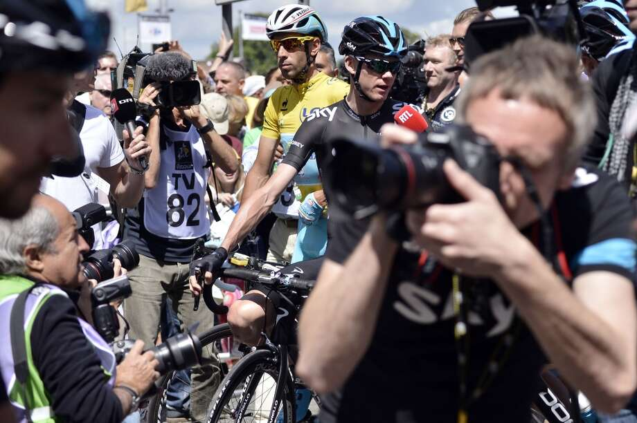 Britain's Christopher Froome and Italy's Vincenzo Nibali wearing the overall leader's yellow jersey wait at the departure village in Cambridge prior to the start of the 155 km third stage. Photo: JEFF PACHOUD, AFP/Getty Images