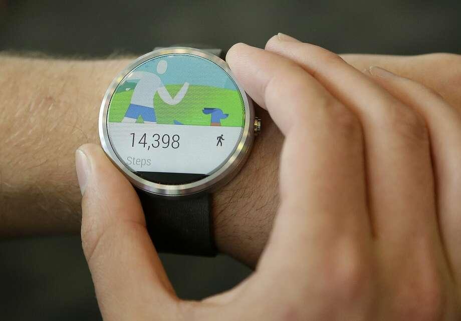 The Moto 360 Android Wear smart watch displays a fitness app. Photo: Jeff Chiu, Associated Press