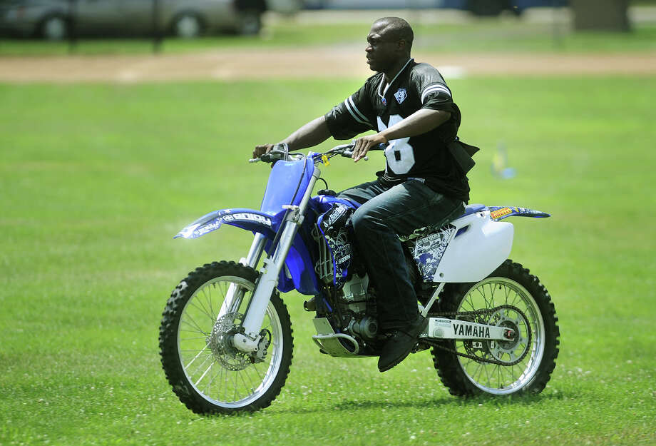 A man on a motocross bike rides illegally across Newfield Park in Bridgeport's East End recently. Residents have been riding the motocross bikes, which aren't street legal, around the city. Photo: Brian A. Pounds / Connecticut Post