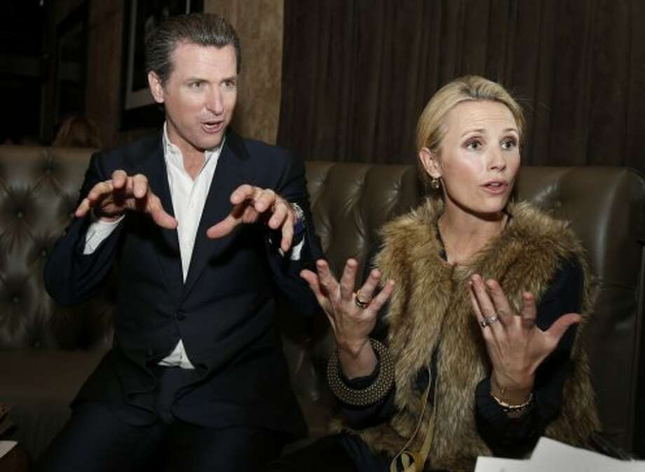 Gavin Newsom and wife Jennifer Siebel Newsom at an event in November 2013. Photo: Brant Ward, The Chronicle