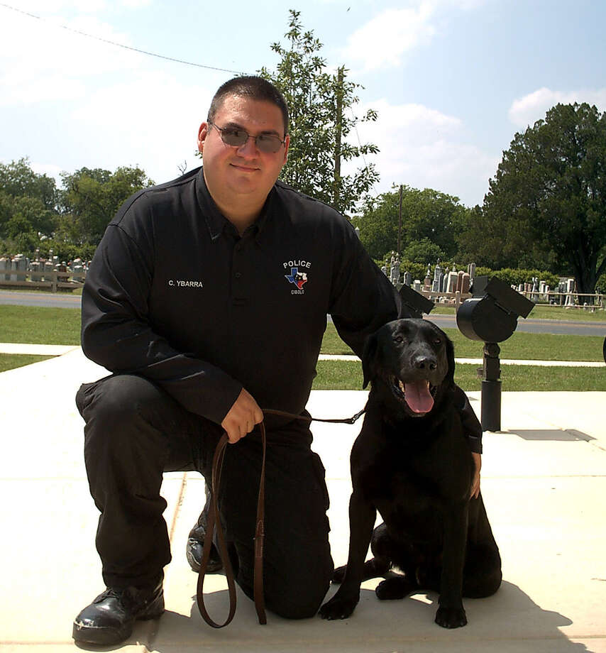 Cibolo Police Officer Chris Ybarra poses with Carlos, the city's new K9 officer. The two are dedicated to detecting illegal drugs. Photo: David DeKunder / Northeast Herald