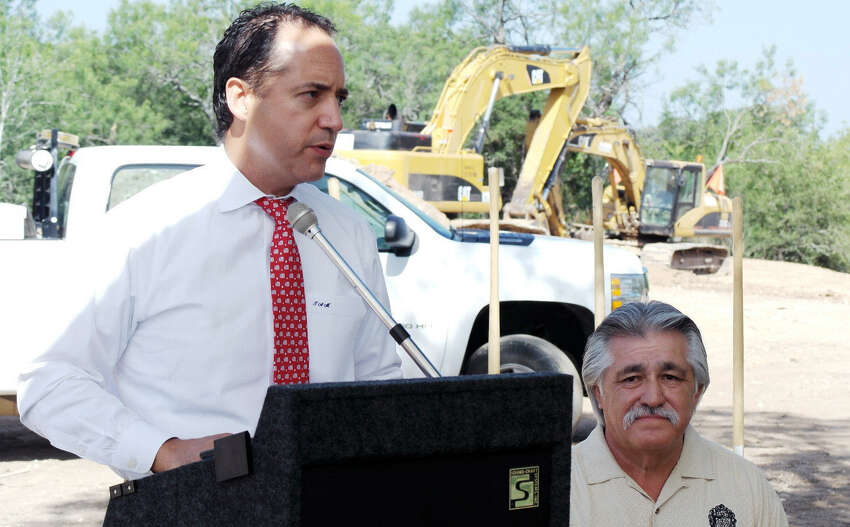 State Rep. Jose Menendez, left, speaks as San Antonio City Councilman Ray Lopez looks on at the Shaenfield Bridge groundbreaking ceremony July 2.