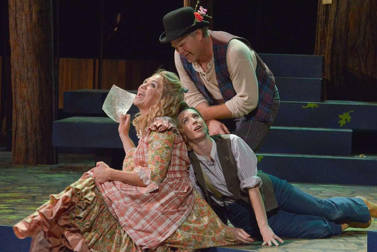 Celia (Greta Wohlrabe, left) and Touchstone (Mike Ryan) tease the lovesick Rosalind (Julia Coffey), disguised as a boy, in Santa Cruz Shakespeare's