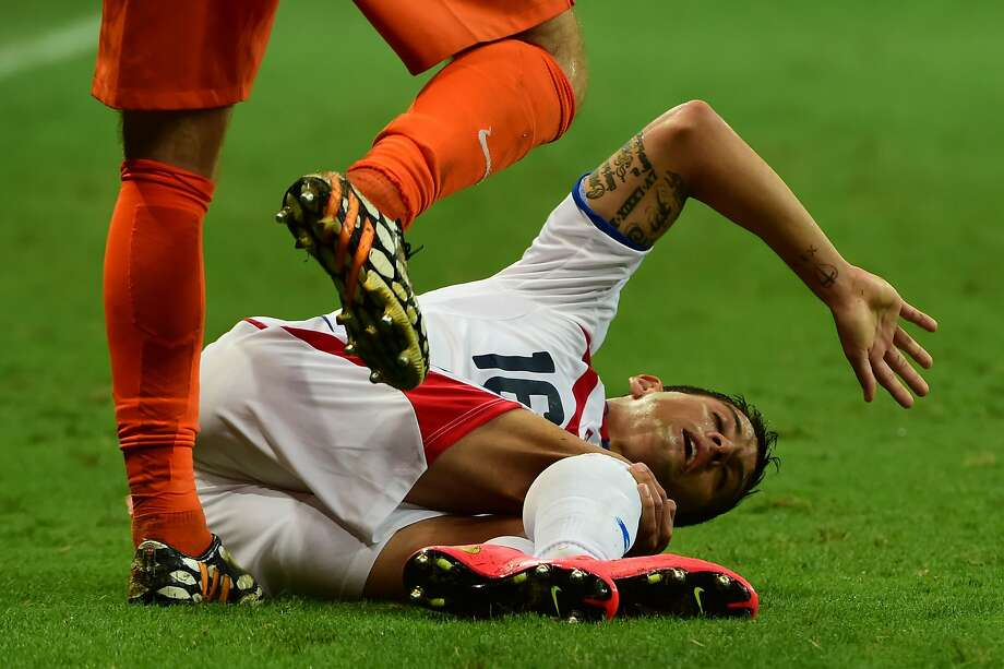 Costa Rican defender Cristian Gamboa grabs his knee during the quarterfinal against the Netherlands. But was he really hurt?Verdict: Yes, indeed. Gamboa left the game with a knee injury. Photo: Ronaldo Schemidt, AFP/Getty Images