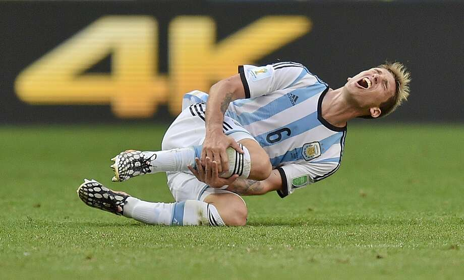 Argentina's Lucas Biglia looks like he's been shot after going down against Belgium in the quarters.Verdict: He's fine. He'll play against the Netherlands in the semis. Photo: Martin Meissner, Associated Press