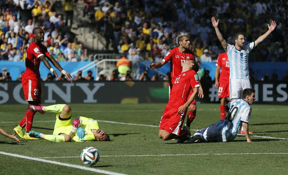 Switzerland's goalkeeper Diego Benaglio goes down in the box, writhing in pain.Verdict: He got up and played the rest of the game. Photo: Victor R. Caivano, Associated Press