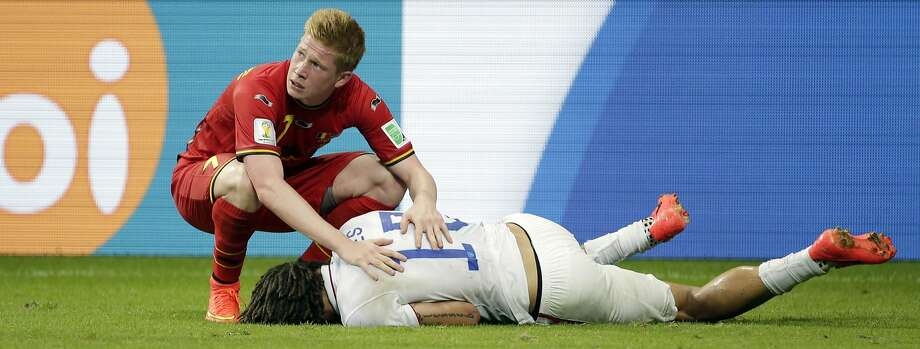 Belgium's Kevin De Bruyne looks pretty concerned about American Jermaine Jones here...Verdict: Jones played the entire match — including extra time. No need to worry, Kevin. Photo: Felipe Dana, Associated Press