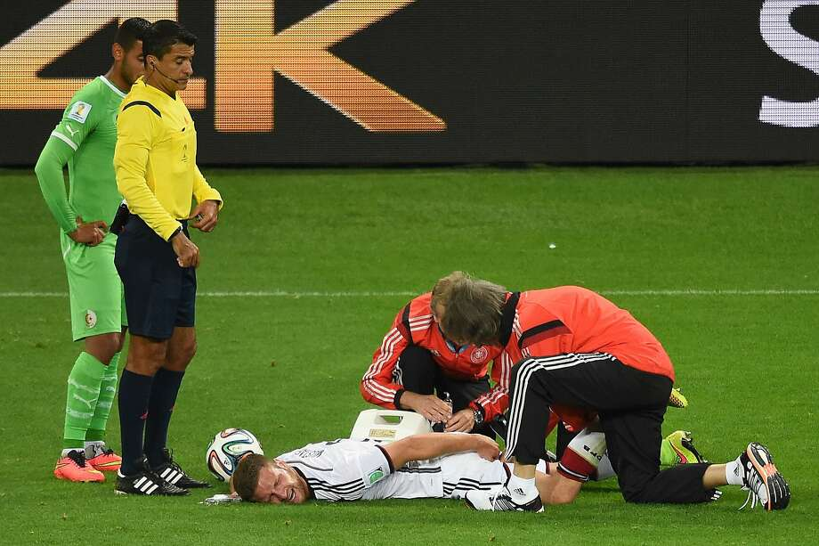 Germany's defender Shkodran Mustafi is tended to by team doctors during the Algeria game.Verdict: Mustafi tore a muscle in his leg and will miss the rest of the World Cup. Photo: Christophe Simon, AFP/Getty Images