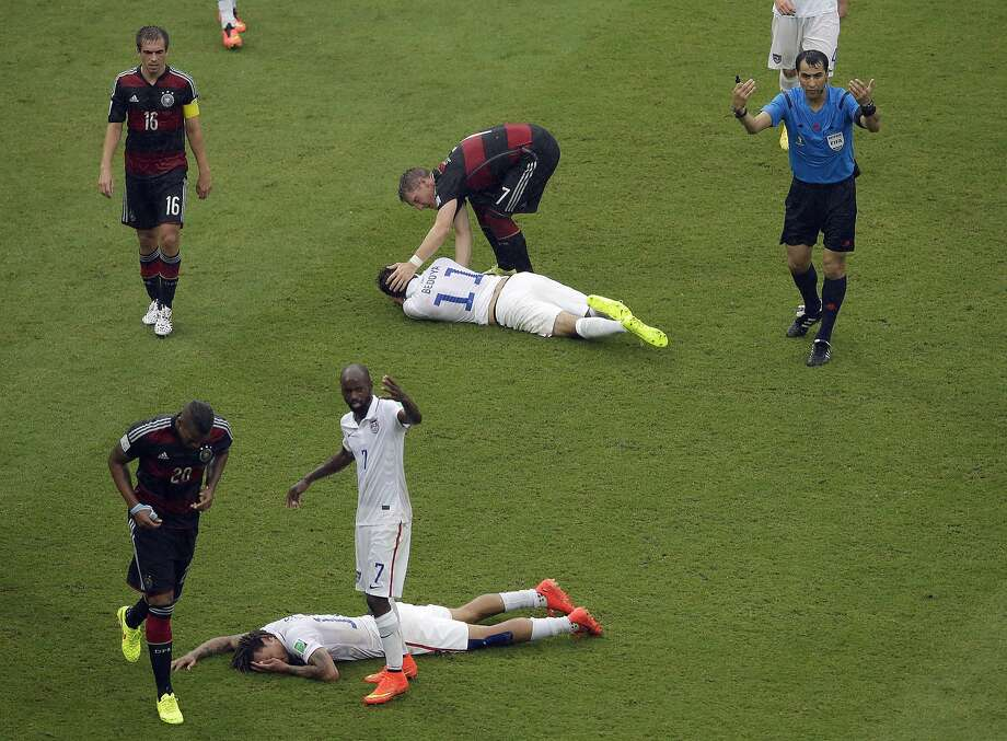 Jermaine Jones and Alejandro Bedoya hit the ground hard after colliding with each other during the Germany game.Verdict: Both were OK, although Jones suffered a suspected broken nose.  Photo: Hassan Ammar, Associated Press
