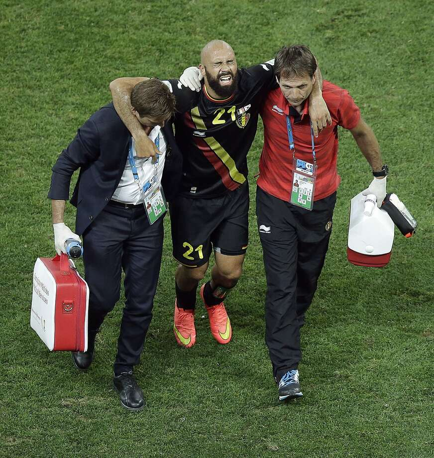 Here's a scene familiar to NFL fans: Belgium right back Anthony Vanden Borre being carried off the field by team doctors.Verdict: Very injured. Vanden Borre broke his ankle. Photo: Andrew Medichini, Associated Press