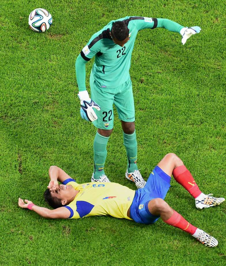 Ecuador's midfielder Cristhian Noboa went down hard after going up for a header against France. But was he really injured? Photo: Francois Xavier Marit, AFP/Getty Images
