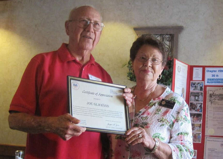 Joe H. Glawson, founding member of San Antonio's Chapter 1594 of the National Association of Retired and Current Federal Employees receives a certificate of appreciation from Chapter President Joyce Zerr at the 36th anniversary luncheon in June 2014. Photo: NARFE