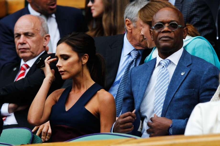 Victoria Beckham and Samuel L Jackson in the Royal Box on Centre Court before the Gentlemen's Singles Final match between Roger Federer of Switzerland and Novak Djokovic of Serbia on day thirteen of the Wimbledon Lawn Tennis Championships at the All England Lawn Tennis and Croquet Club on July 6, 2014 in London, England. Photo: Pool, Getty Images