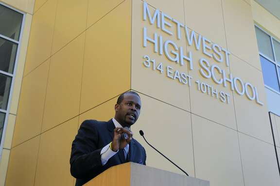 New Oakland superintendent of schools Antwan Wilson hold a news conference in front of Metwest High School during the first day on the job in Oakland, Calif. on Tuesday, July 1, 2014. Wilson takes over Oakland's schools system after a similar post in Denver.