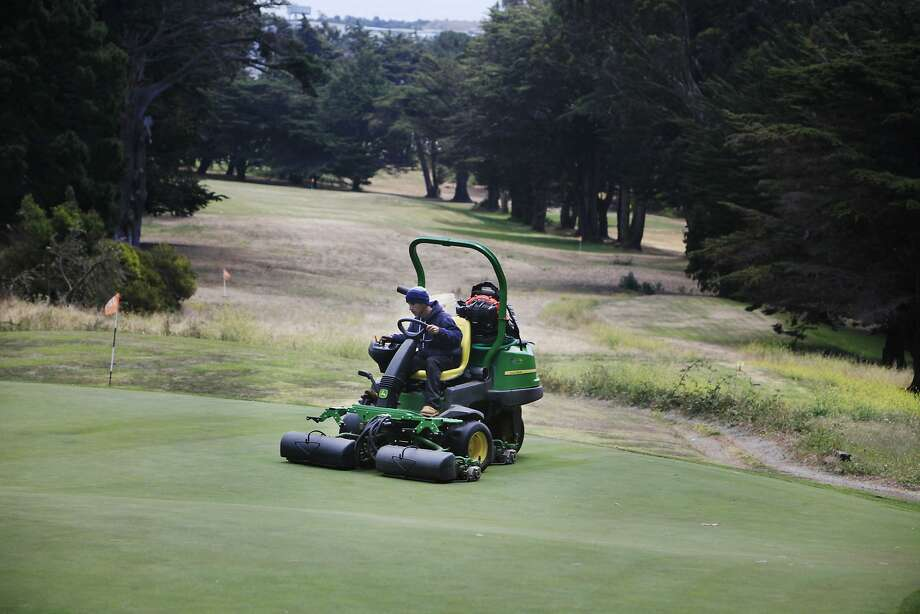 Gabriel Castillo mows the greens at the Gleneagles Golf Course in San Francisco, which is open until the end of July. Photo: Lea Suzuki, The Chronicle