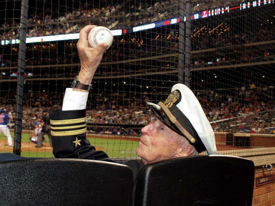 """Standard displays a ball that was flipped over the screen to him by the Texas Ranger batboy during the July 4 matchup between the Mets and the Rangers at Citi Field. """"He caught it backhand,"""" says Tom Healey, a friend of Standard's and a fellow member of the Greenwich Retired Mens Association. Photo: Contributed Photo / Greenwich Time Contributed"""
