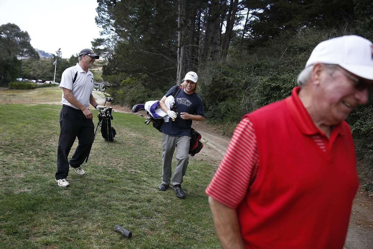 Scott Whatmore (l to r)of South San Francisco, Matt Snyder of San Francisco and Alex Robles, Gleneagles Golf Course starter, share a laugh while talking as they play a game at Gleneagles Golf Course on Monday, July 7, 2014 in San Francisco, Calif.