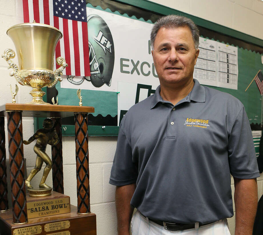 Michael Inco, Kennedy High School's new athletic director and head football coach, poses Thursday with the Salsa Bowl trophy the Rockets won last year. Photo: Marvin Pfeiffer / Southside Reporter / Express-News 2014