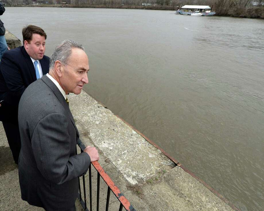 Senator Charles Schumer, center, looks over the deterioration of the the Troy seawall Tuesday morning, April 15, 2014, inTroy, N.Y.  Schumer is joined by Tom Nardacci of Gramercy Communications and director of the Troy BID.  (Skip Dickstein / Times Union archive) Photo: Skip Dickstein / 00026496A