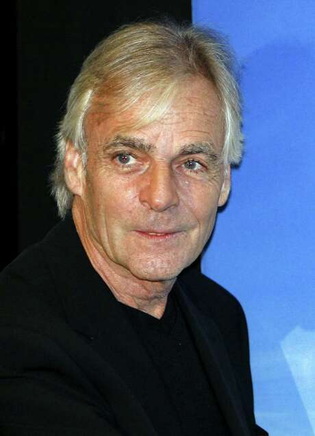 ** FILE ** In this July 3, 2006 file photo, Richard Wright of Pink Floyd attends a screening for the group's latest DVD, in central London's Leicester Square. Wright, a founding member of the rock group Pink Floyd, died Monday, Sept. 15, 2008. He was 65. Pink Floyd's spokesman Doug Wright, who is not related to the artist, said Wright died after a battle with cancer at his home in Britain. (AP Photo/Lefteris Pitarakis, file) Photo: LEFTERIS PITARAKIS, STF / AP