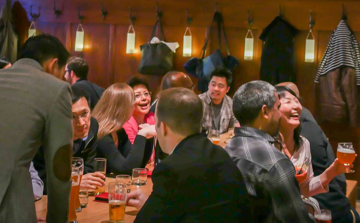 People enjoy happy hour at Schroeder's in San Francisco, Calif., on Thursday, July 3rd, 2014.