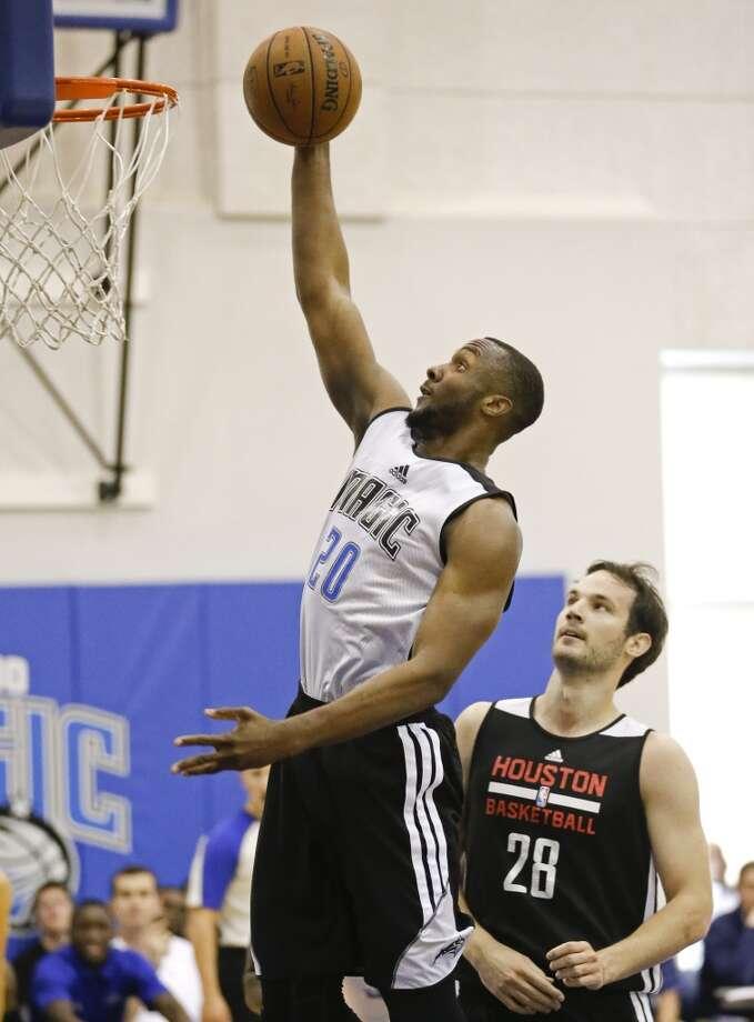 July 7: Magic 87, Rockets 69 Orlando Magic's Kadeem Batts (20) makes a shot as he gets past Houston Rockets' Miro Bilan (28). Photo: John Raoux, Associated Press
